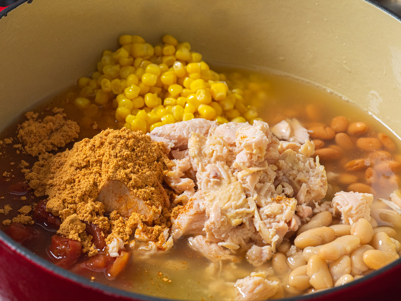 Once canned goods have been drained (and rinsed in the case of the beans) combine all ingredients into a large stock pot set on medium-high.