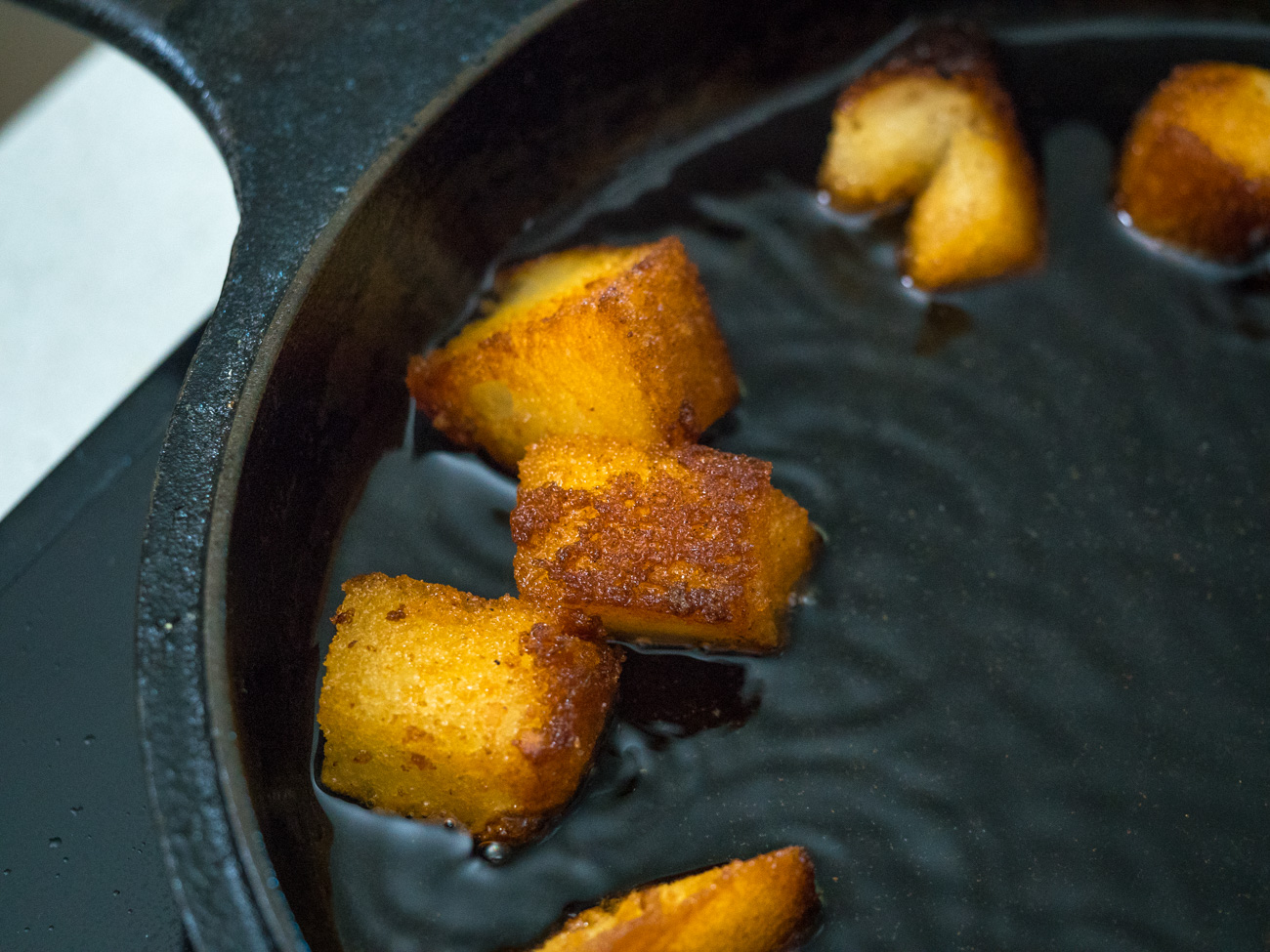 Heat vegetable oil on low-medium heat. Working in batches, fry cubes until golden brown, then immediately put cubes into cinnamon sugar mixture and toss to coat.