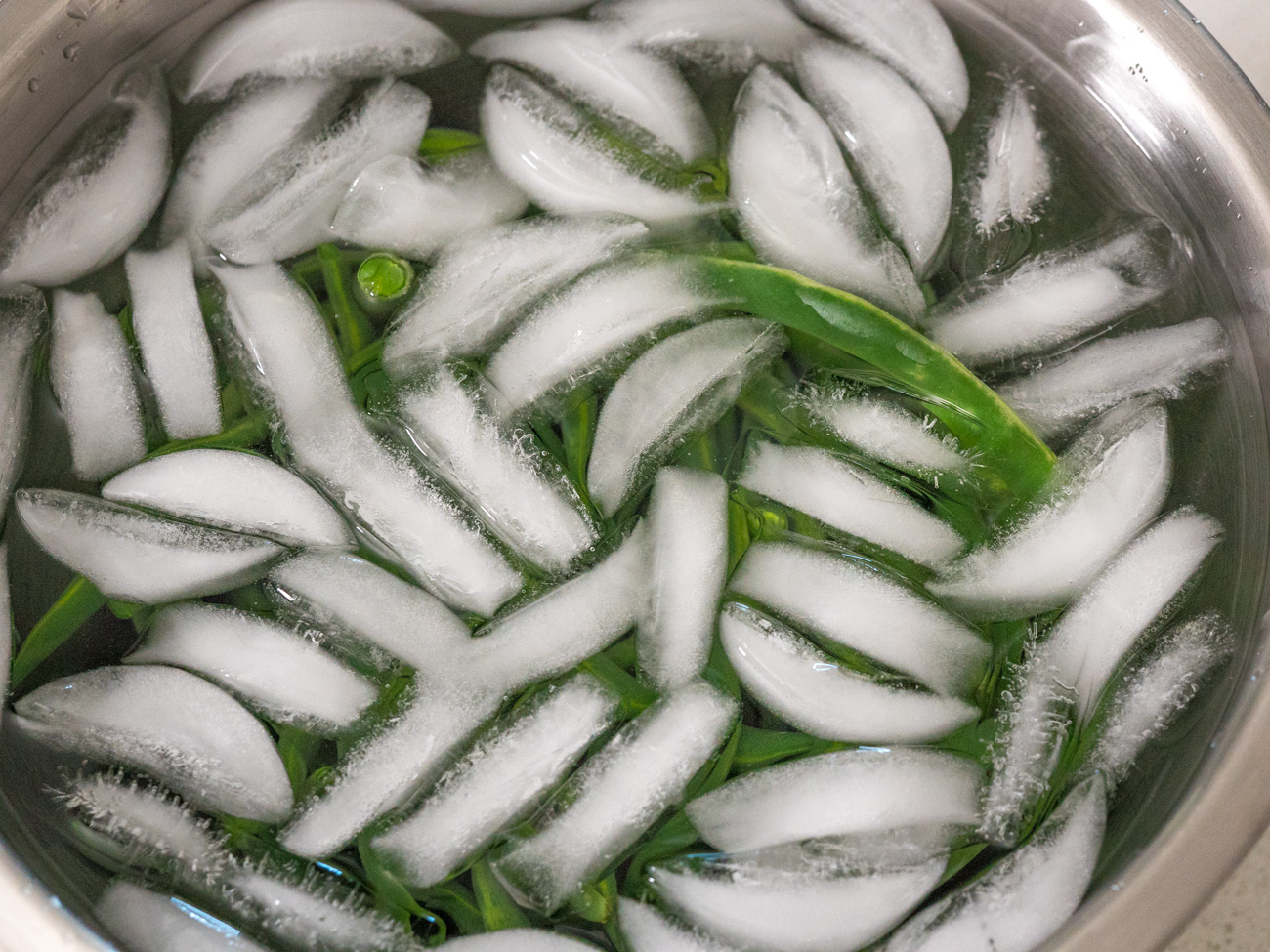 After the 3 minutes are up, strain green beans and then dunk them into the ice water for about 1 minute.