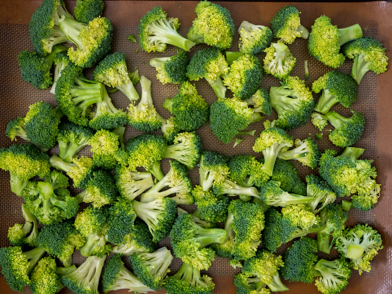 Wash and cut broccoli florets into bite-sized chunks.