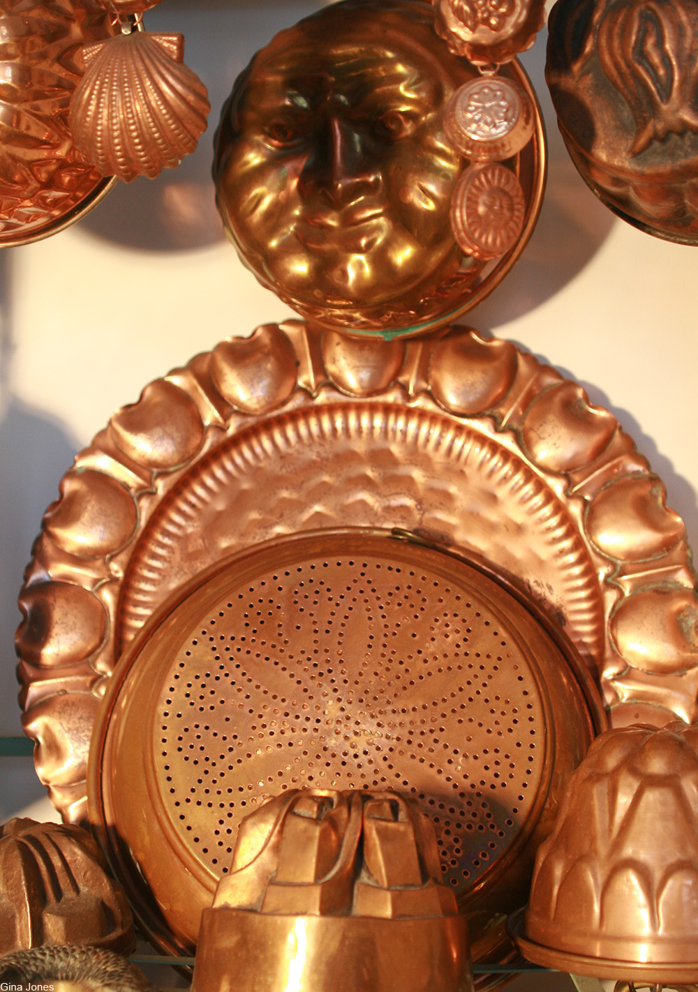 a display of copper molds