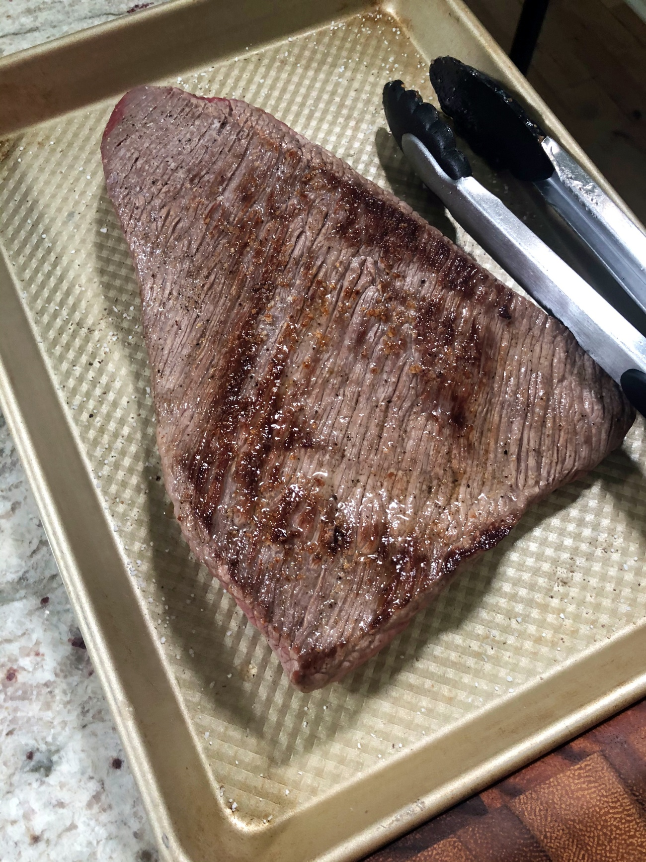 Add the brisket, fat side down. Sear for about 1 minute per side, building a nice dark crust, then remove.