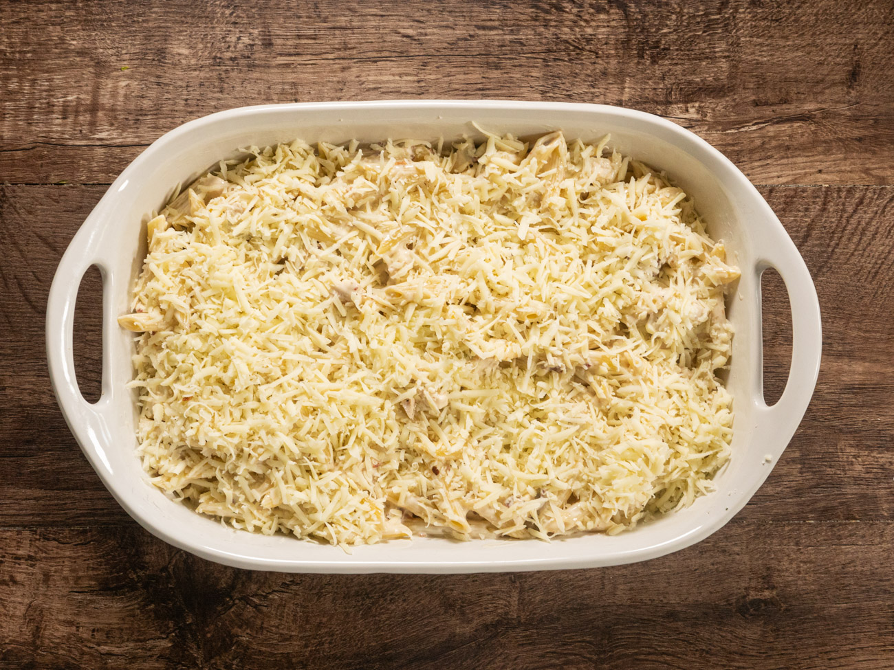 Pour into baking dish and level with a spoon. Top casserole with mozzarella cheese.