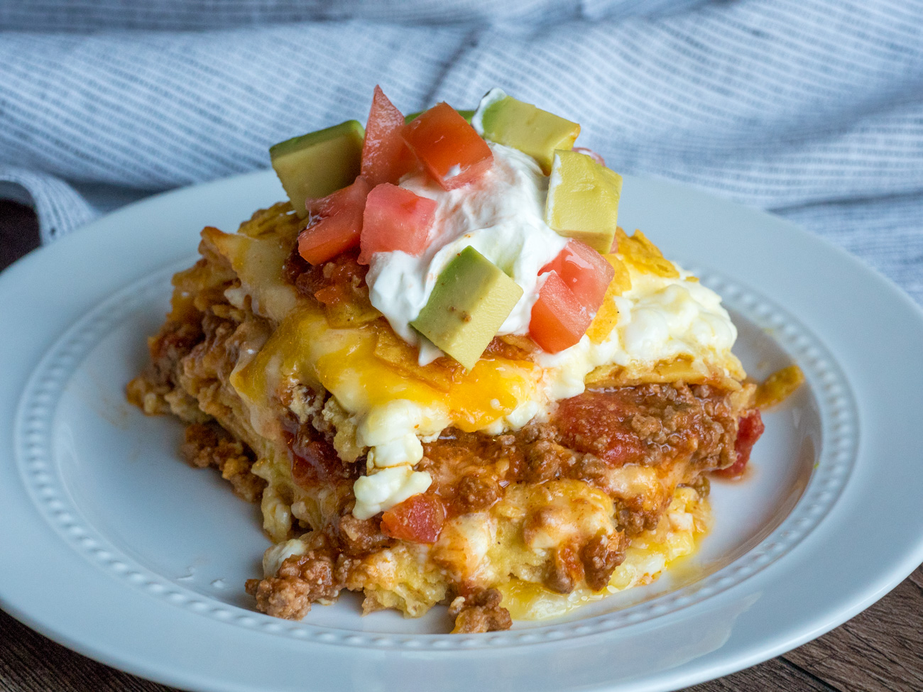 Bake for 30 minutes or until bubbly. Let cool for 5 minutes before topping with tortilla chips, avocado chunks, diced tomato, and salsa. Serve up hot and enjoy!