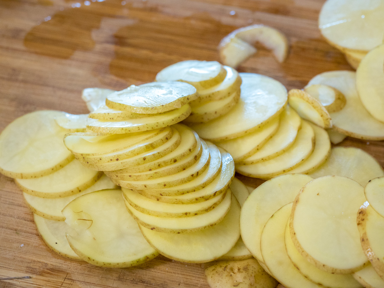 Use a mandoline to slice the potatoes thinly, or chop by hand into 1/8 inch thick slices.