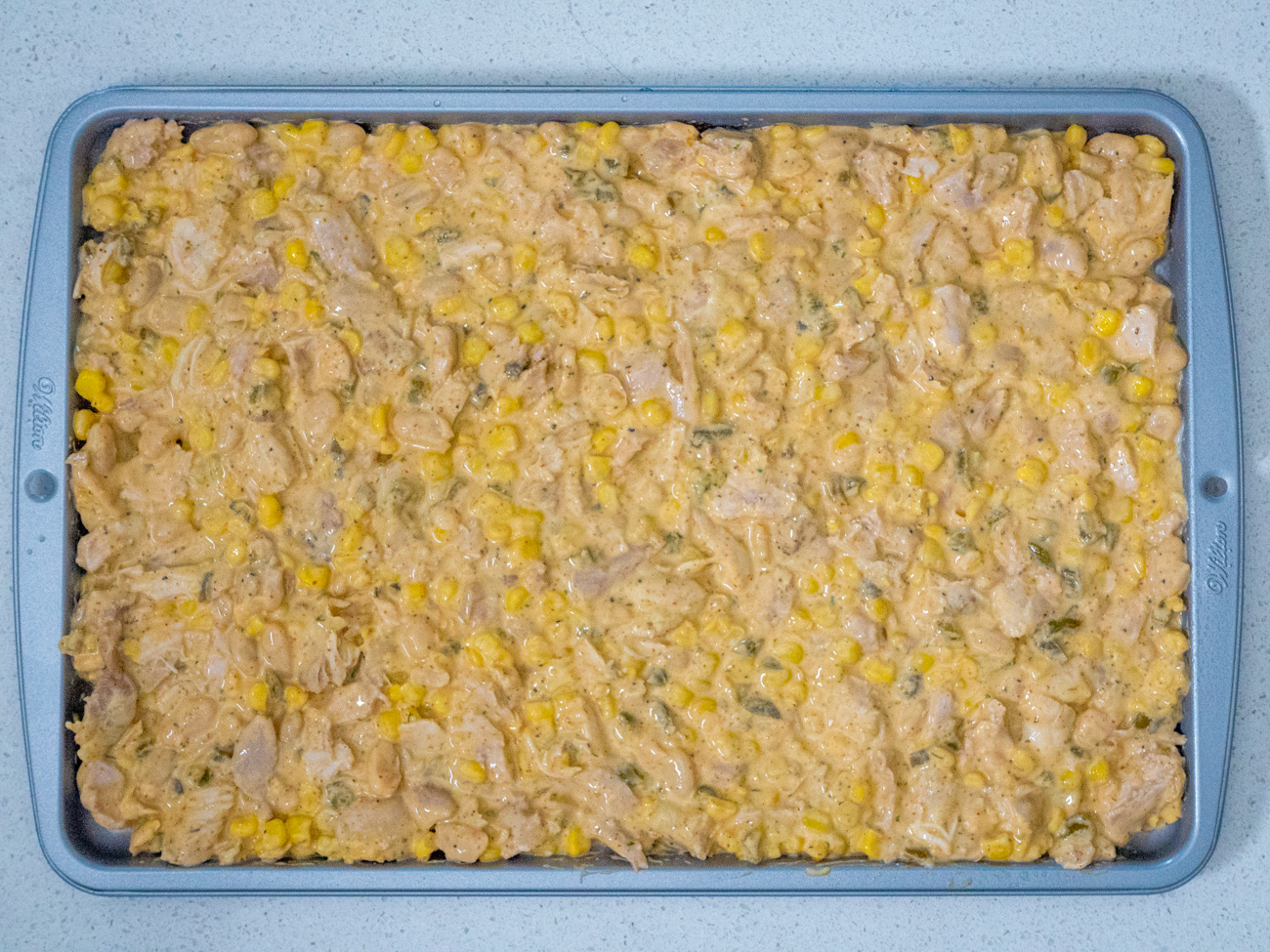Cut chicken into 1-inch pieces. Stir chicken into chili mixture. Spread evenly on sheet pan.