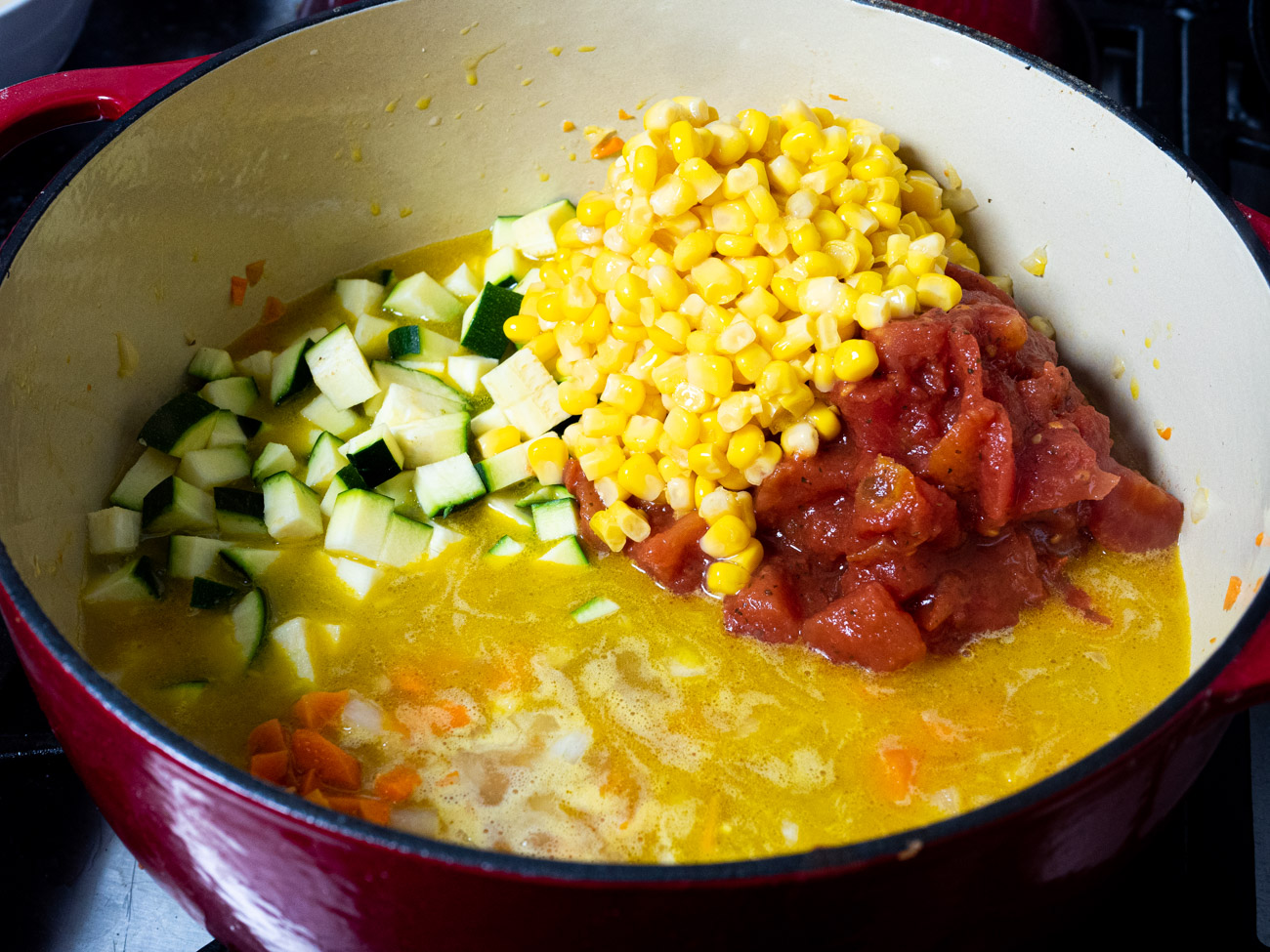 Add zucchini, tomatoes, corn, and seasonings. Heat for another 10-15, until mixture begins to boil.