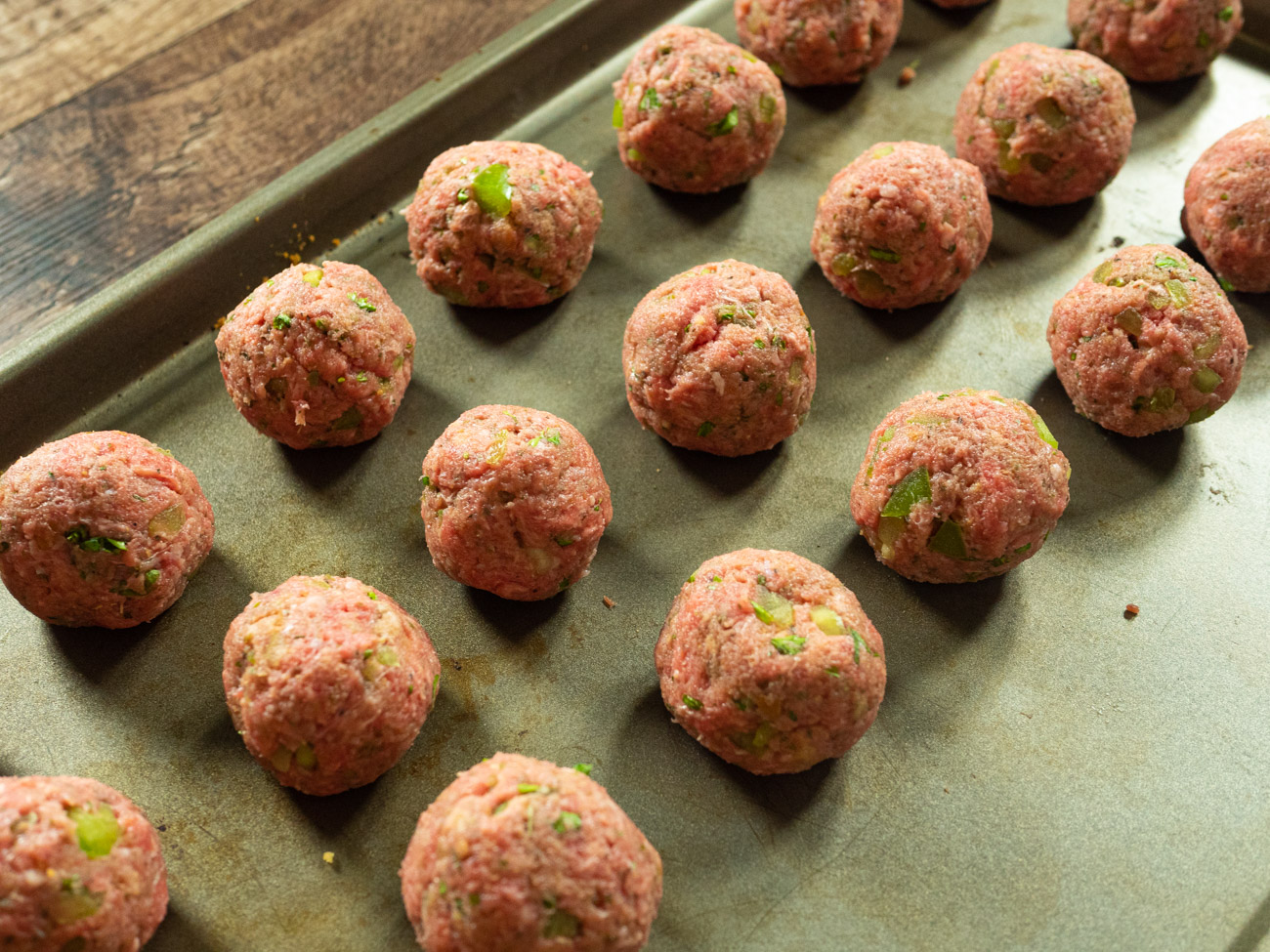 Form into 20 equal meatballs using a small scoop or you hands. Place in single layer on rimmed baking sheet.