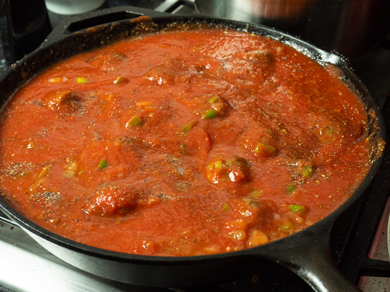Add Italian seasoning and tomato sauce and reduce heat to medium-low heat. Gently place meatballs in sauce and fold to coat with sauce, but do not stir or break up meatballs.