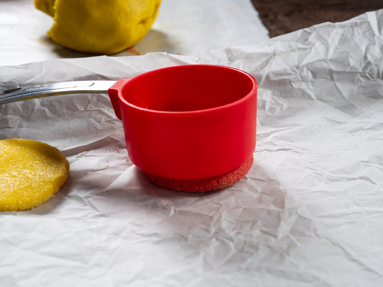 Pour remaining Jello into 4 small bowls. Roll dough into 1-inch balls and dip in coordinating Jello mix powder. Flatten each cookie with the bottom of a mug or cup, but don't press too hard or else the edges will become cracked.