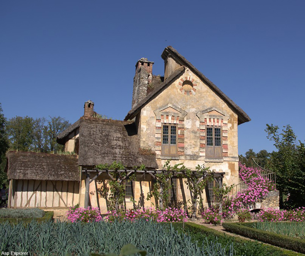 One of quaint buildings of Le Hameau de la Reine.