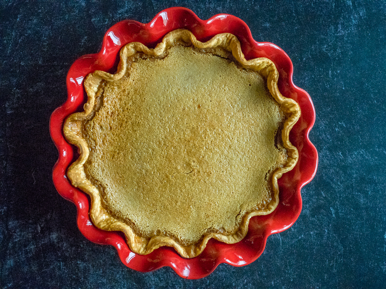 Bake for 60-65 minutes, or until the center is set. (It will still seem slightly jiggly in the very center, but a knife put in the center should come out nearly clean.)