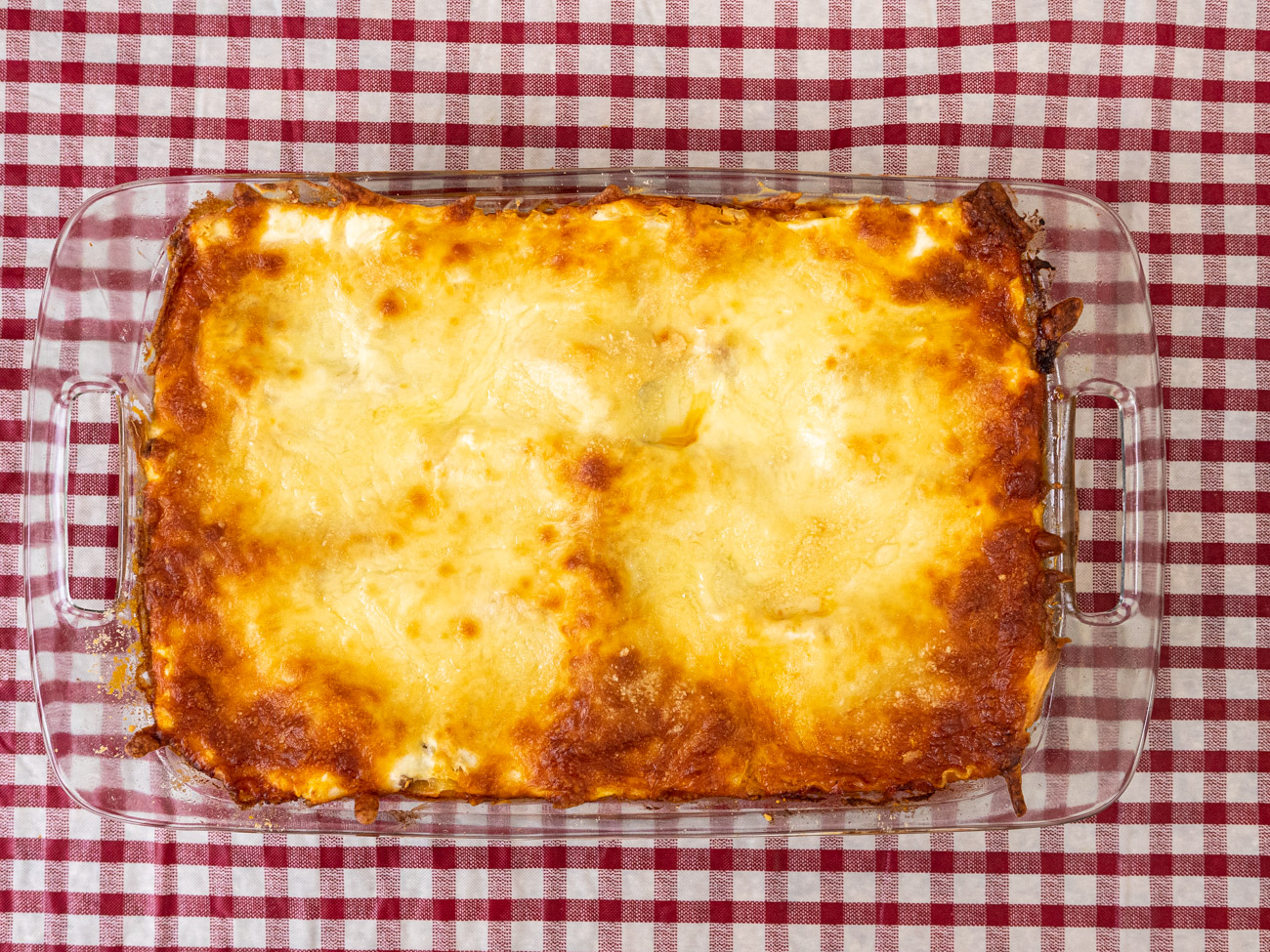Bake 40 minutes or until cheese is melted and sauce is bubbling. Allow to cool for 15 minutes before serving.