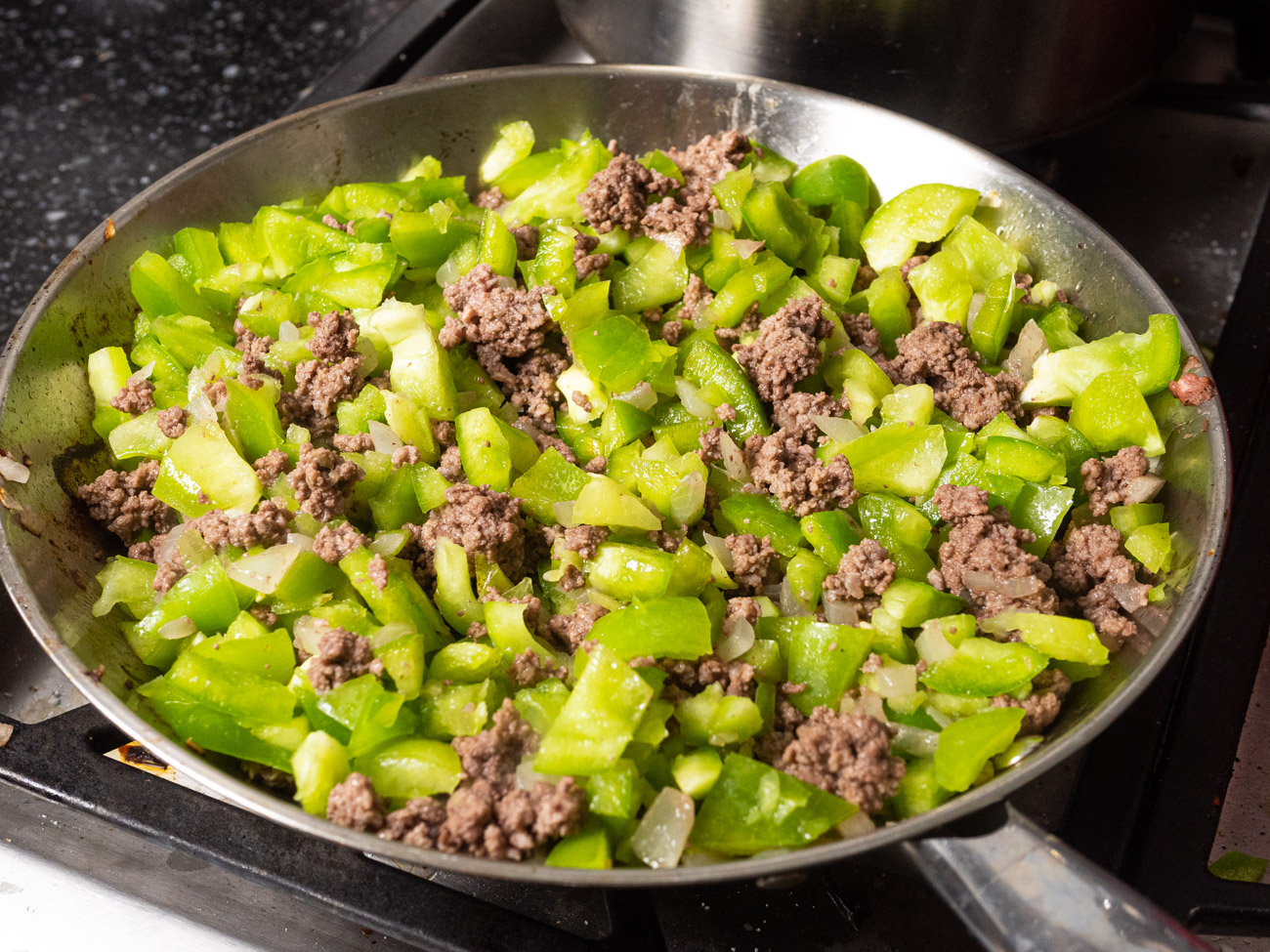 Add bell peppers to the skillet and sauté until they soften (about 3 minutes).