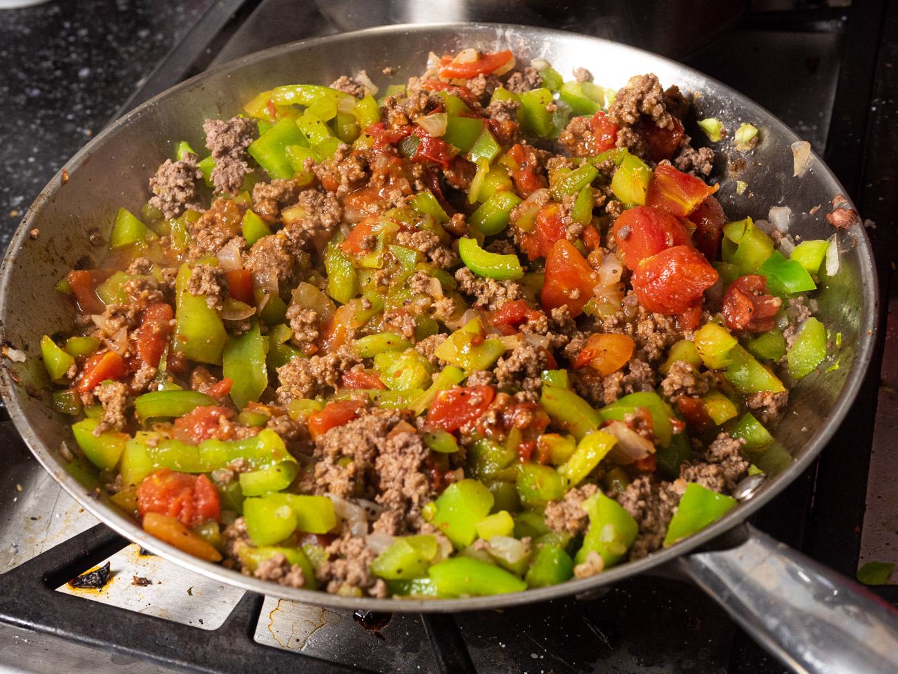 Add garlic, salt, pepper, tomato paste, diced tomatoes, and Worcestershire sauce to the skillet and bring to a boil.