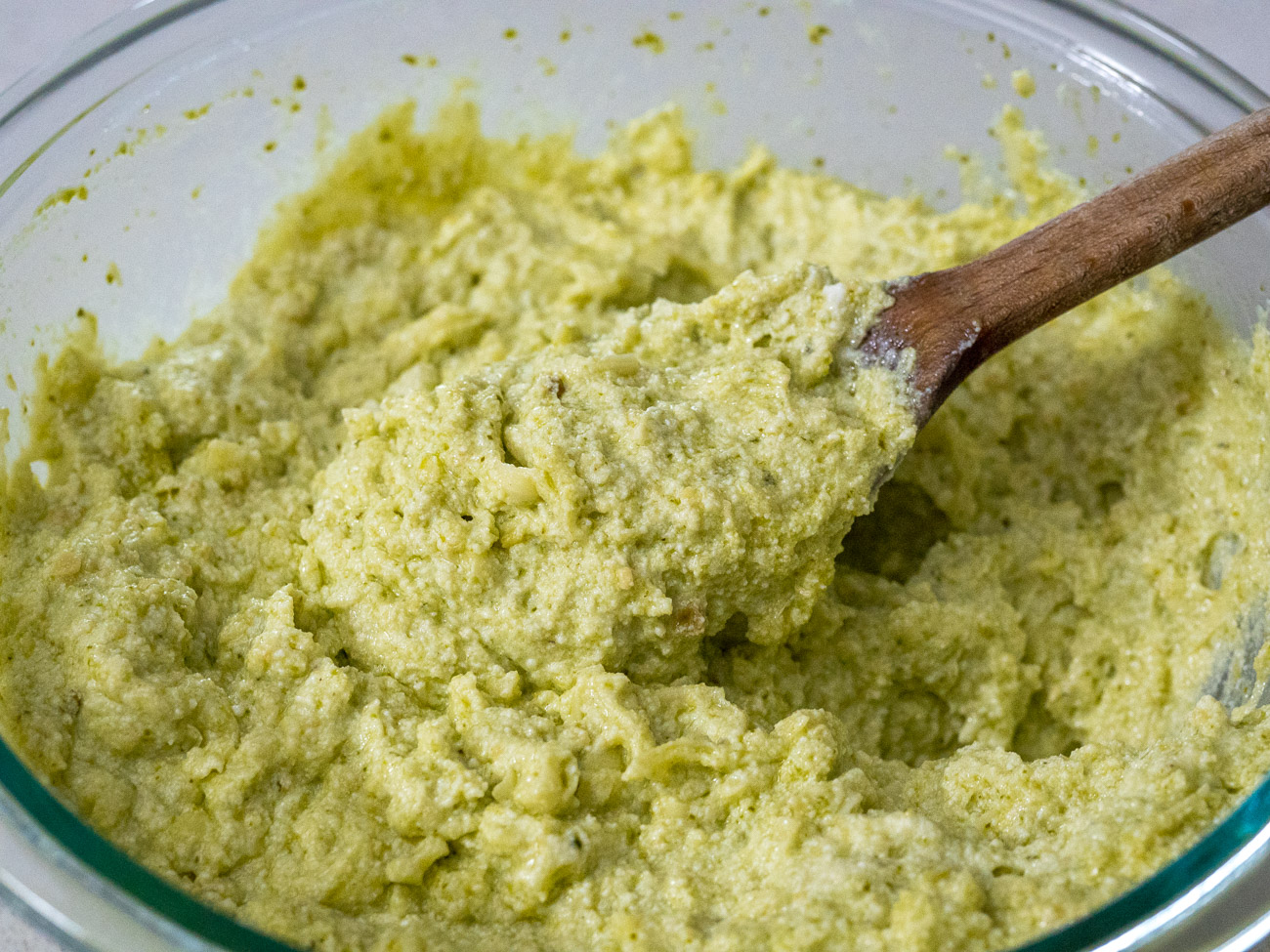 Combine ricotta, fontina, and 1/2 cup pesto in a medium bowl.