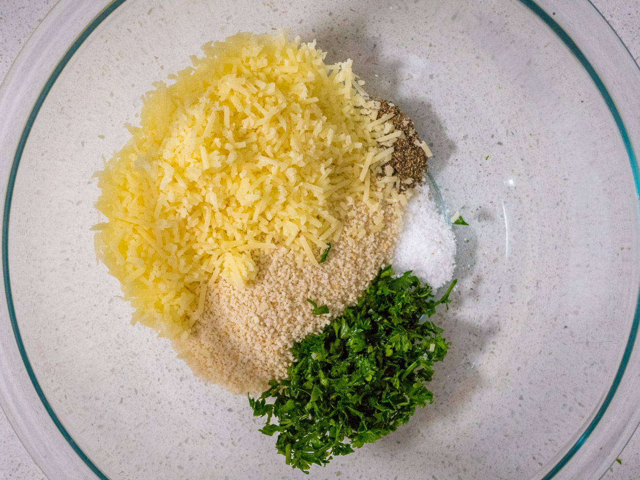 In a small bowl combine bread crumbs, cheeses, parsley, salt, pepper. Preheat oven to 350˚.