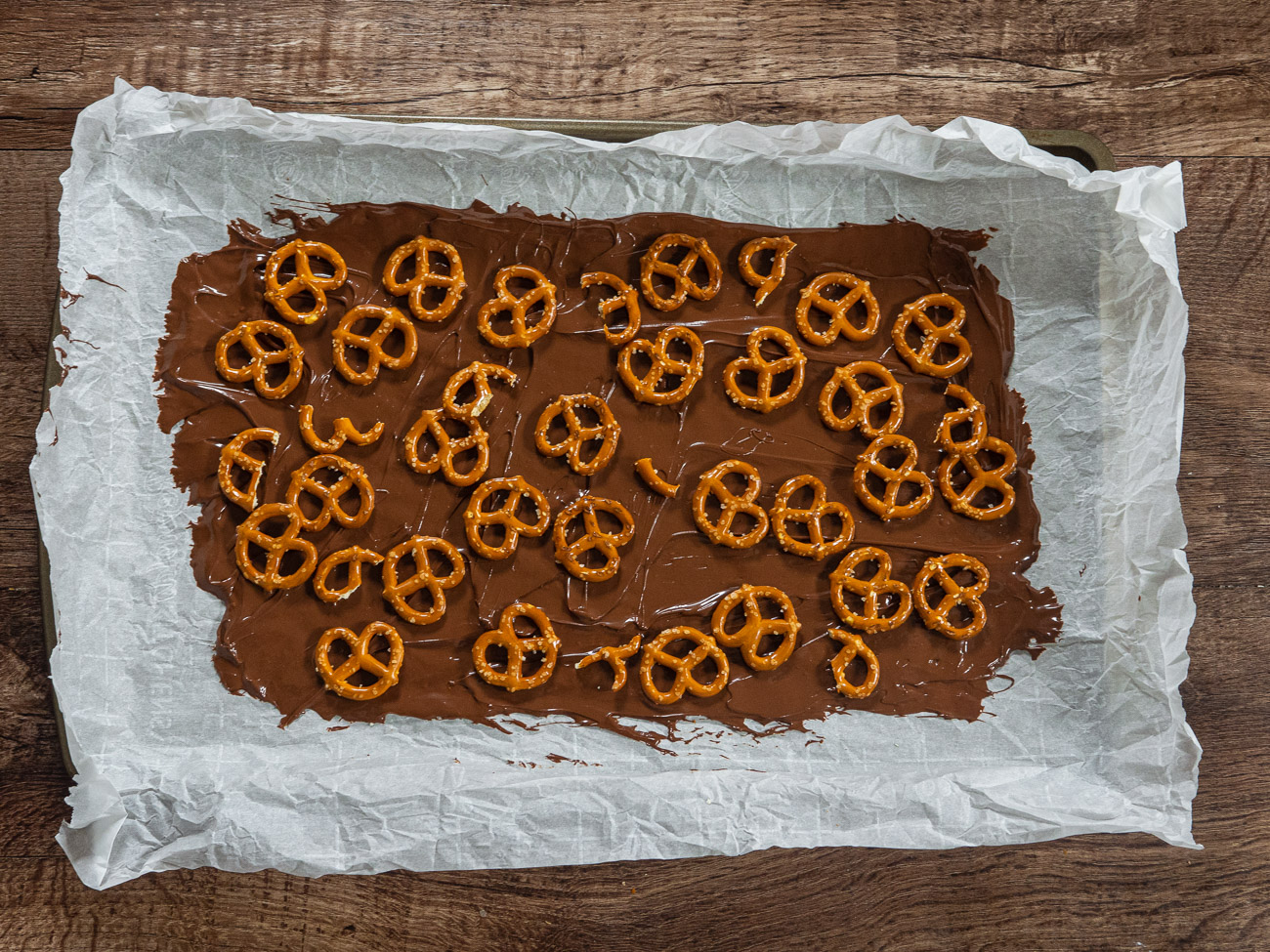 Spread an even layer of pretzels over the chocolate.