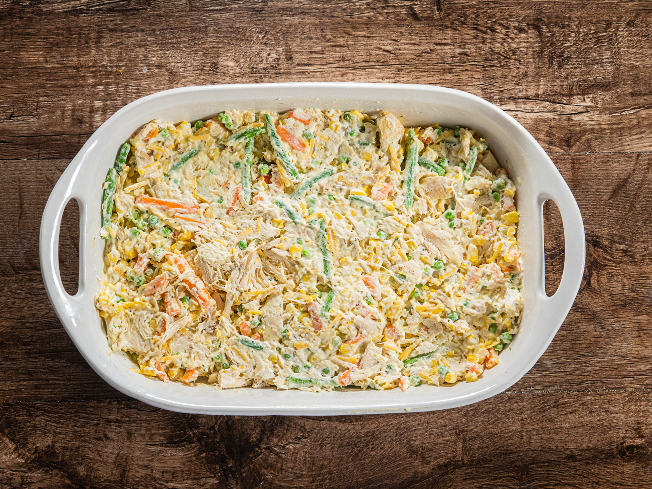 Pour into prepared casserole dish then top with tater tots, lined up neatly in rows.