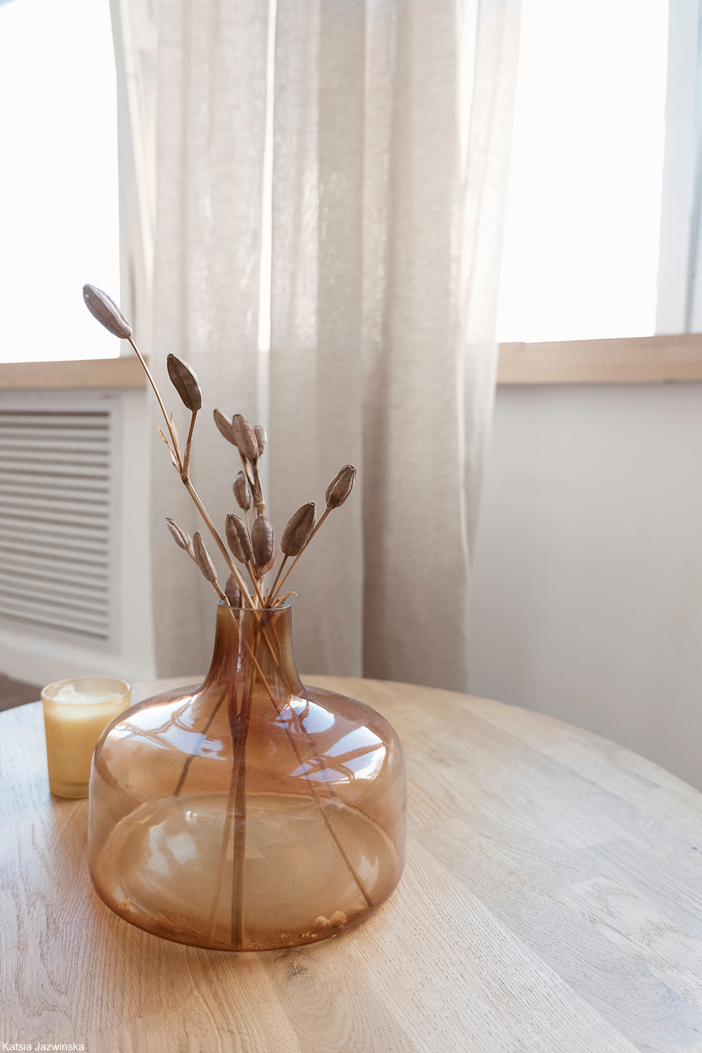 glass vessel with dried plants inside