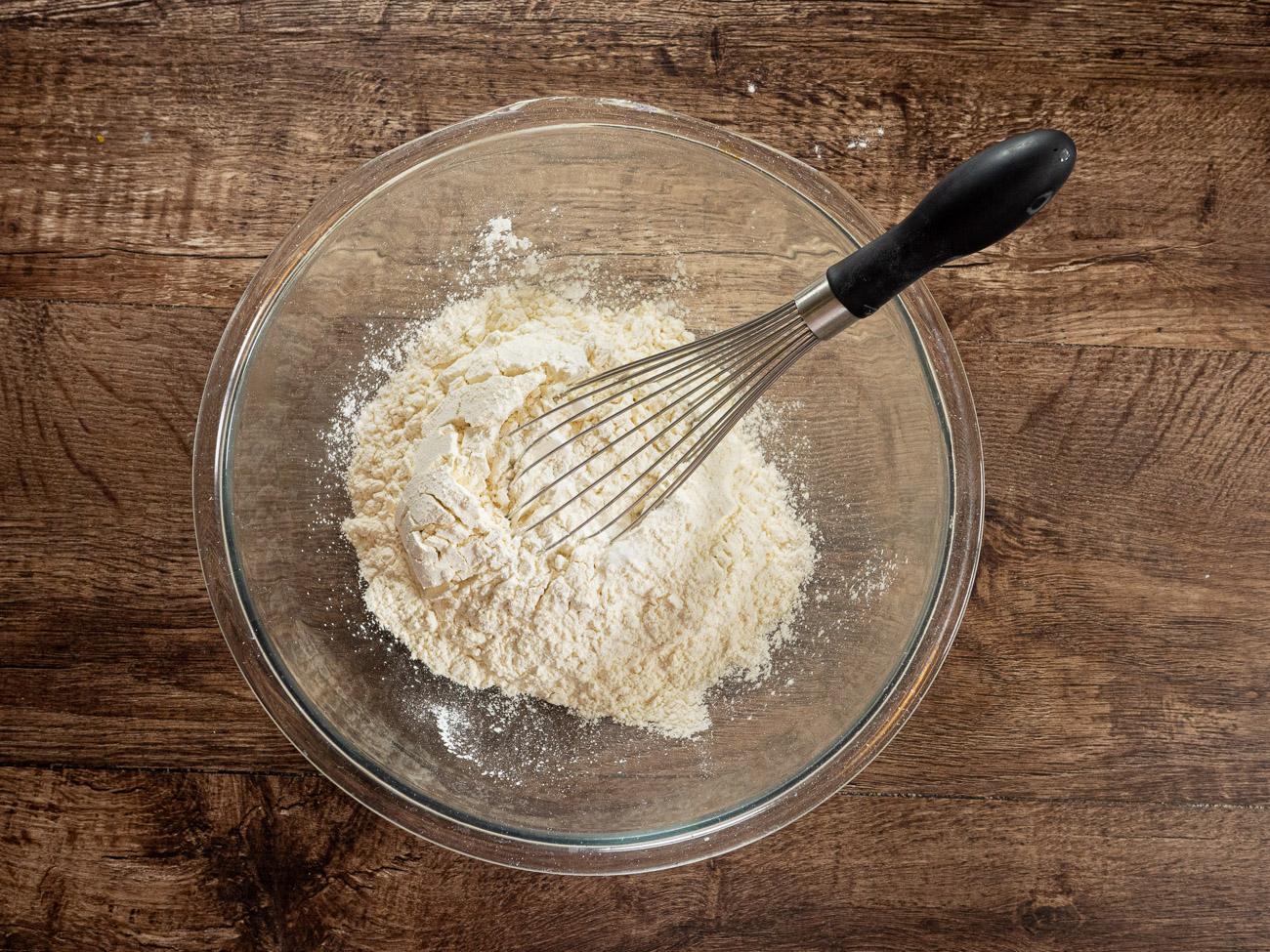 In a medium bowl whisk together flour, baking powder, and salt.