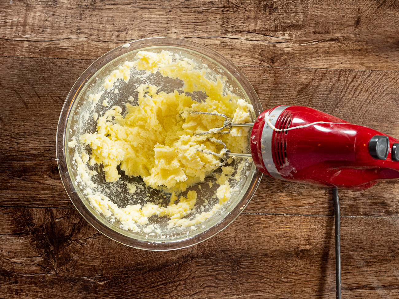 In a separate large bowl cream together butter and sugar using an electric mixer.  Slowly add flour mixture and blend until a smooth dough is achieved.