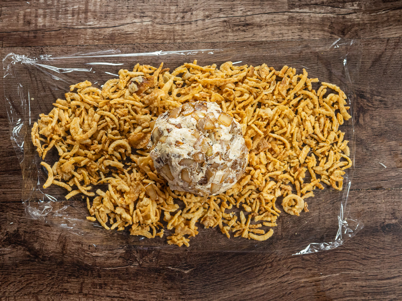 Before serving, roll ball in French fried onions. Enjoy!