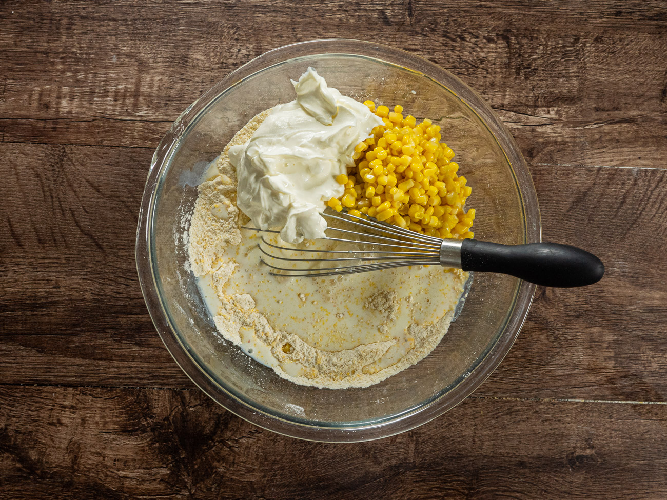 Add corn, sour cream, and milk, and stir to combine.