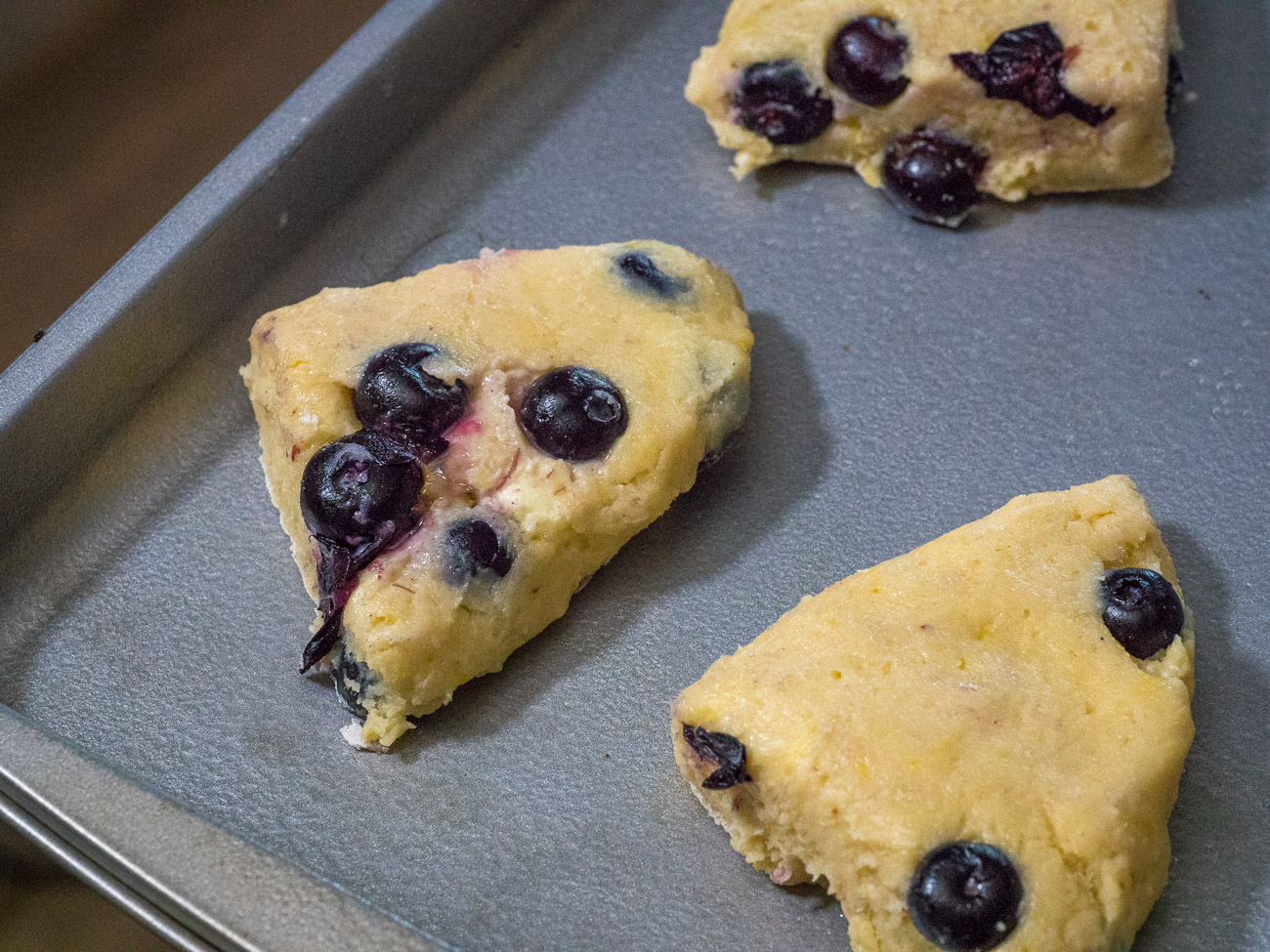 Place scones on greased or lined baking sheet 2-3 inches apart and refrigerate for 15 minutes. Preheat oven to 400˚F.