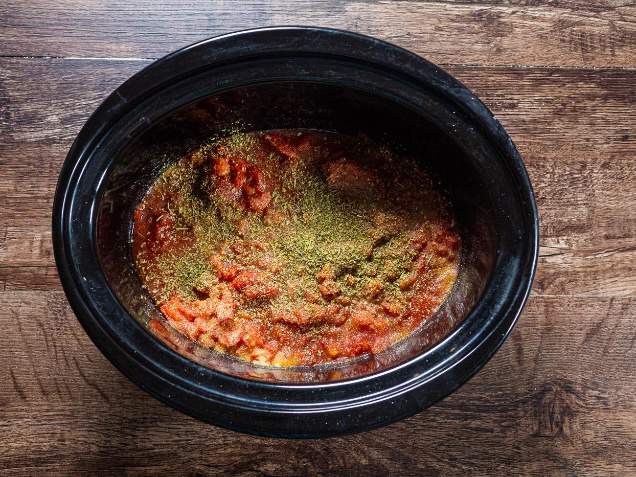 Stir in garlic powder, Italian seasoning, salt, and pepper, then add the stock and Velveeta. Cook on high for 1 hour.