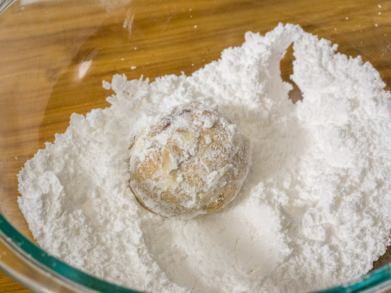 Add powdered sugar to a small bowl. Allow cookies to cool for 5 minutes and then roll each one in powdered sugar.