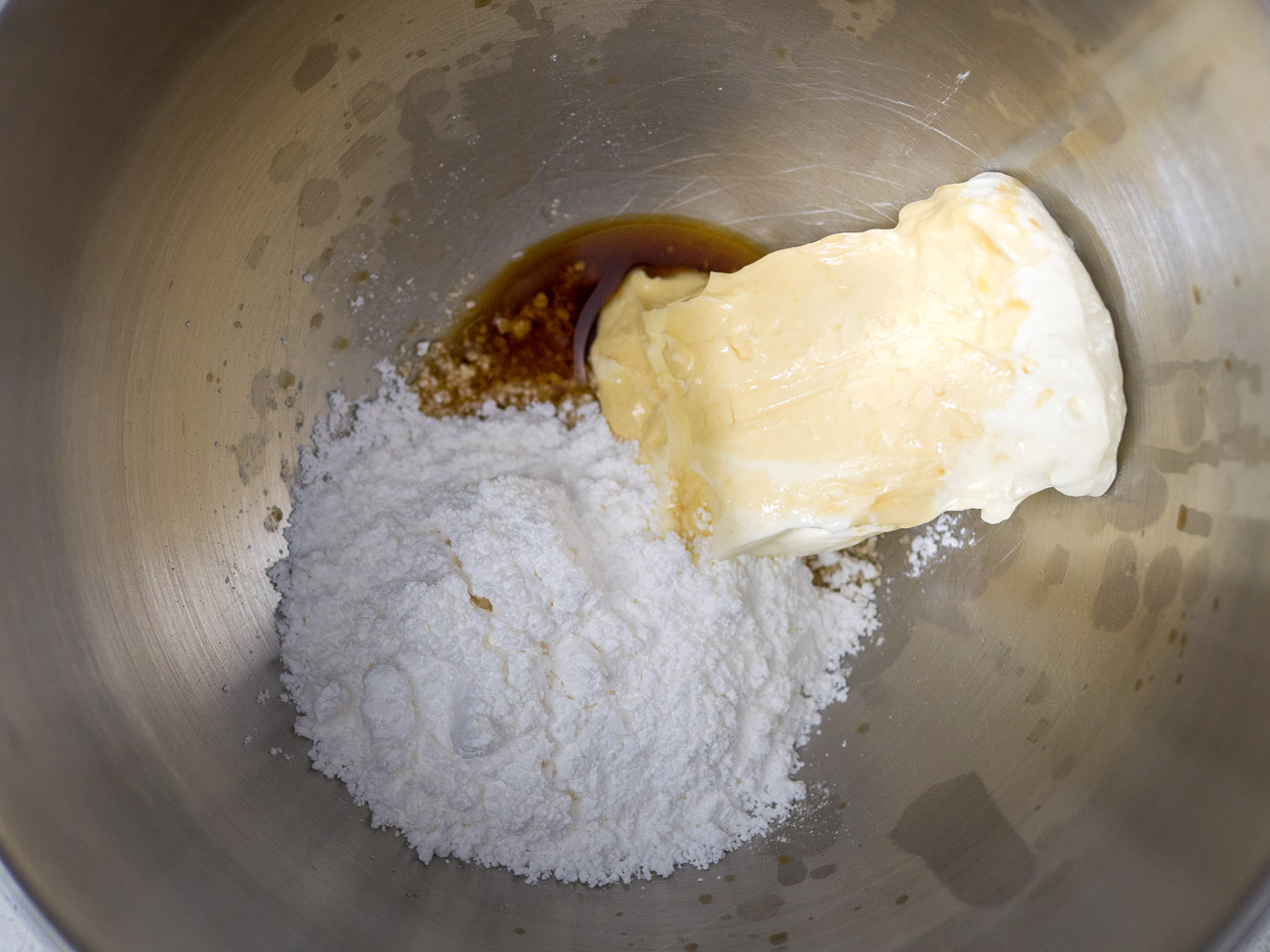 Beat cream cheese, powdered sugar, vanilla extract, and peppermint extract in a large mixing bowl. Gradually add heavy cream and beat until stiff peaks form.