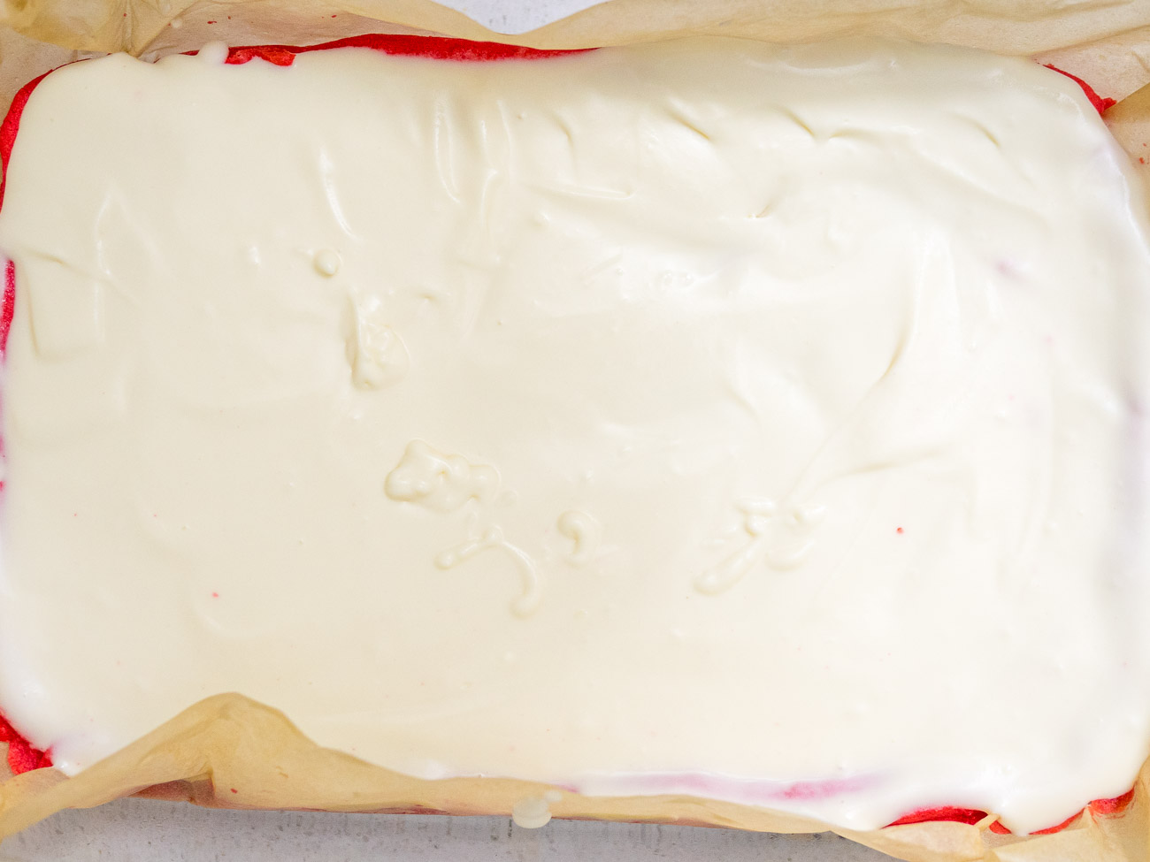 Spread evenly on cooled cookie layer. Place in the refrigerator or freezer for 30 minutes.
