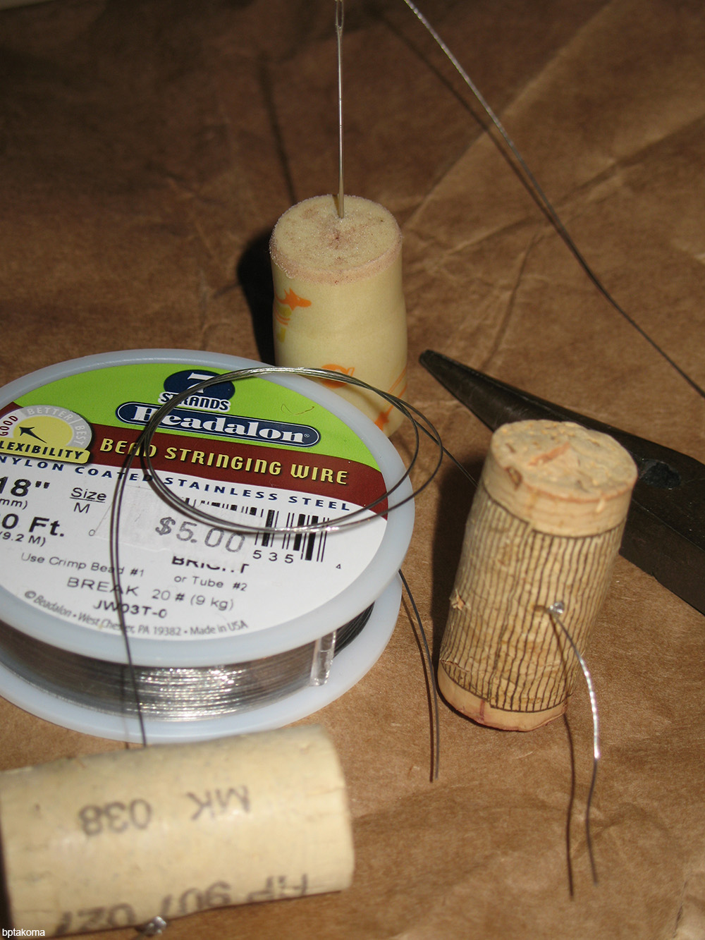 corks being used to hold sewing needles