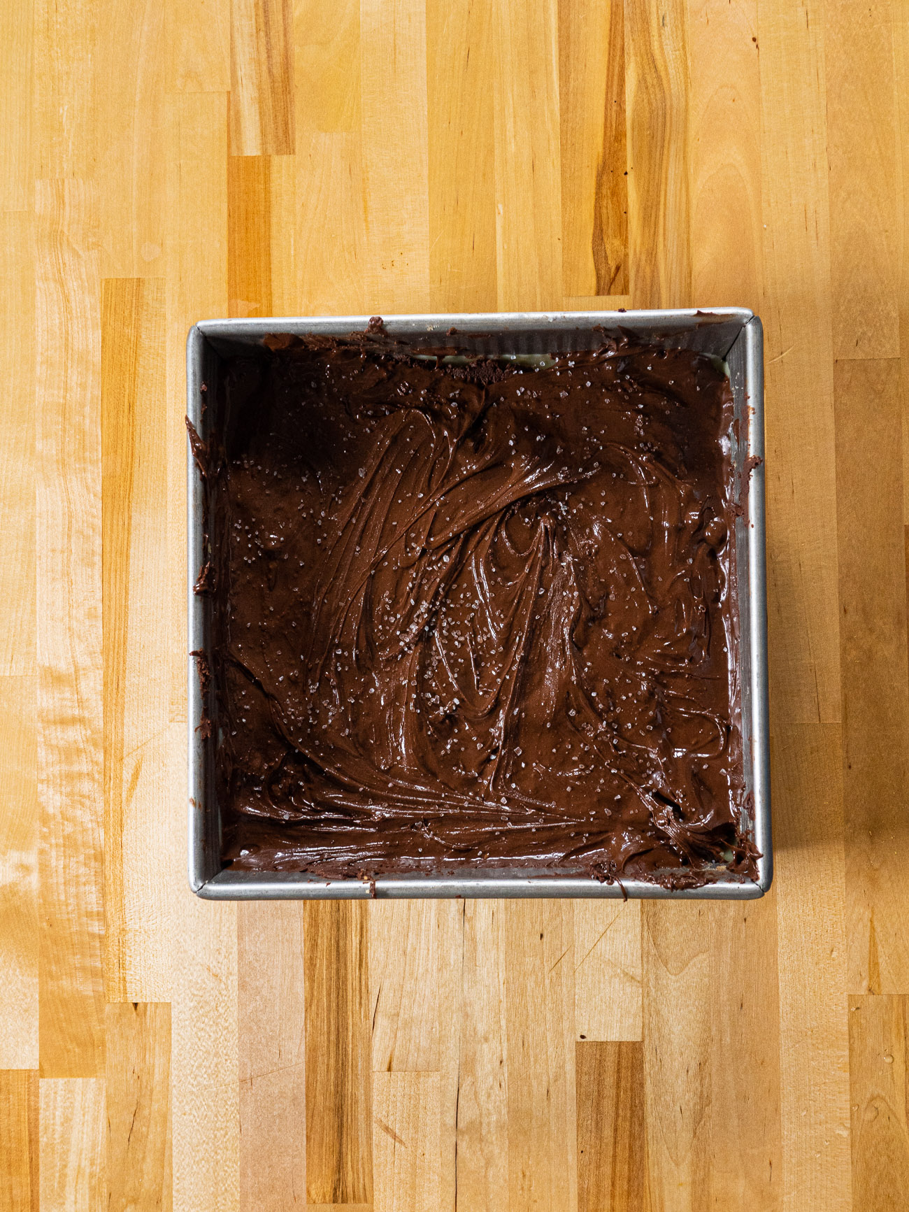 Melt the chocolate together with 1 tablespoon butter. Pour over the caramel layer. Sprinkle coarse sea salt over top and refrigerate until hardened. Cut into bars.