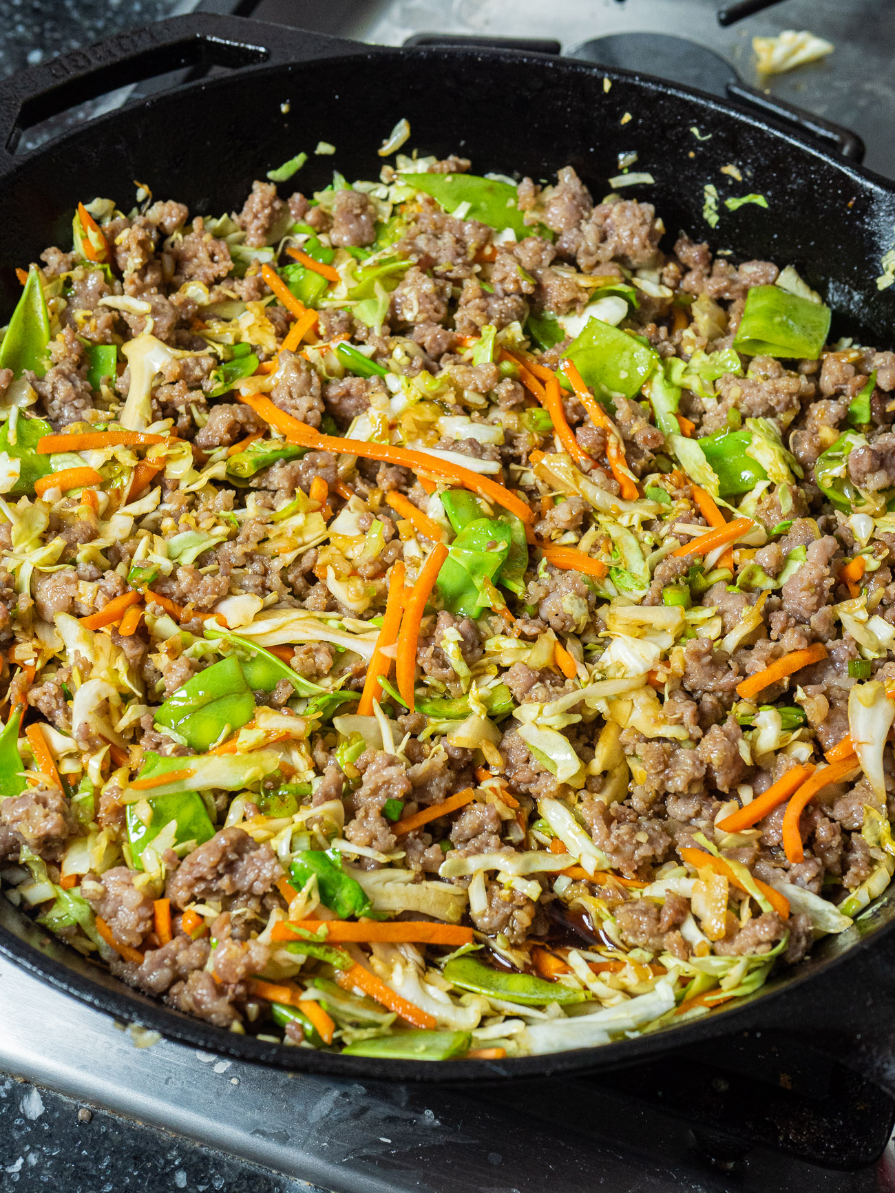 Remove from heat and let noodles stand 1 to 2 minutes, stirring occasionally until all of the liquid is absorbed. Add noodles to bowl with pork mixture, stirring to combine. Spoon mixture into baking dish and cover with foil.