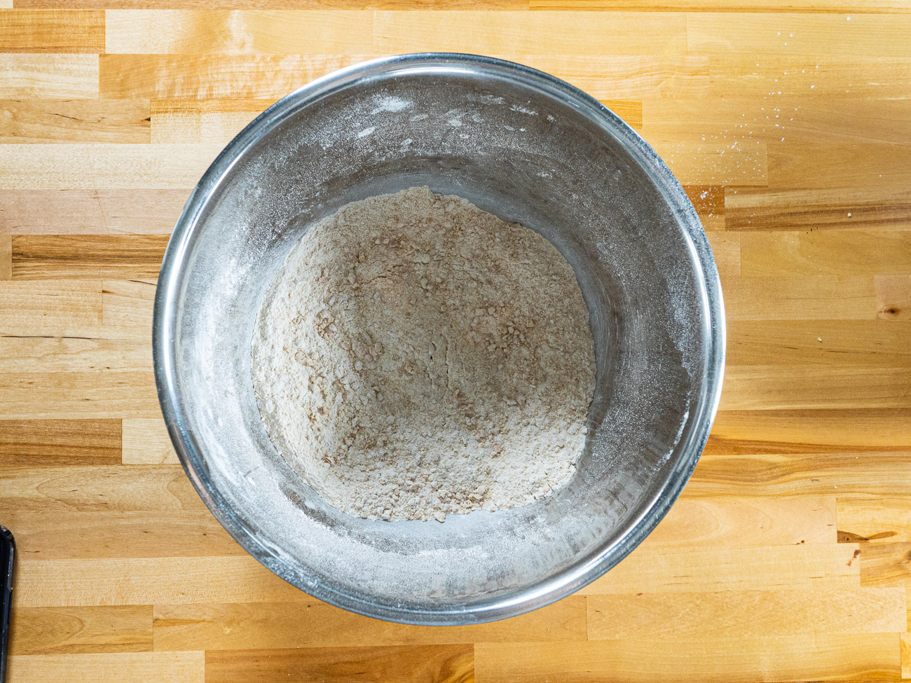 In a separate bowl, combine flour, 1 cup graham cracker crumbs, salt, and baking soda.