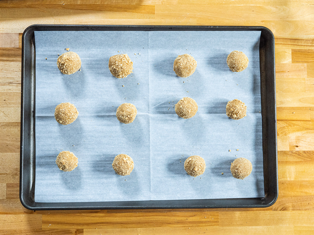 Place the cookie dough balls several inches apart on prepared baking sheets. Bake 8-11 minutes, rotating the pan half way through.