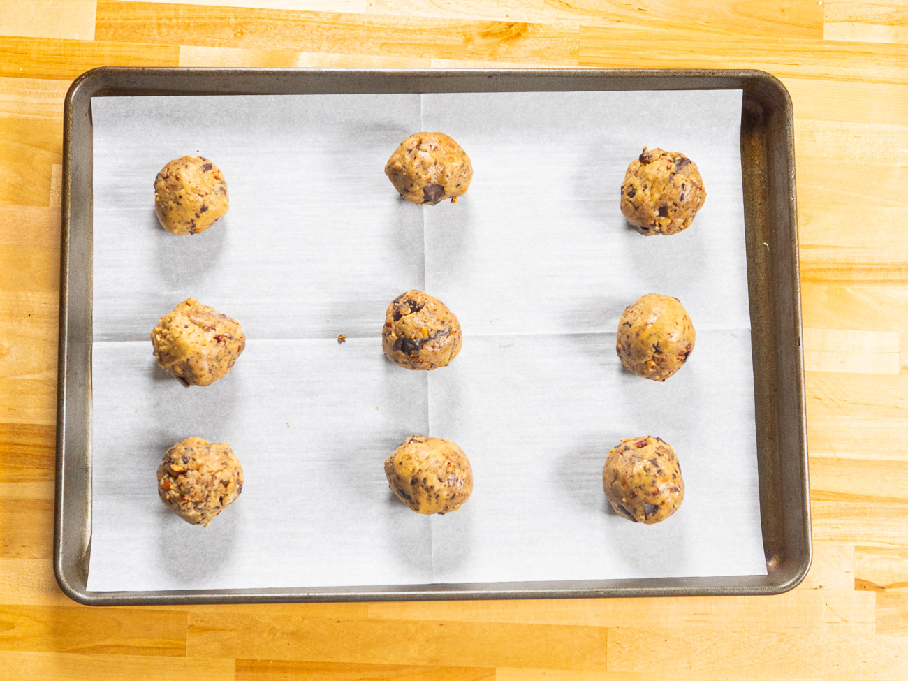 Roll 3 tablespoon-sized scoops of dough between your palms to form a ball (they should be big; almost a 1/4 cup), then place on prepared sheets (make sure to leave enough room in between each cookie for inevitable spreading). Top with a pecan on each cookie ball.