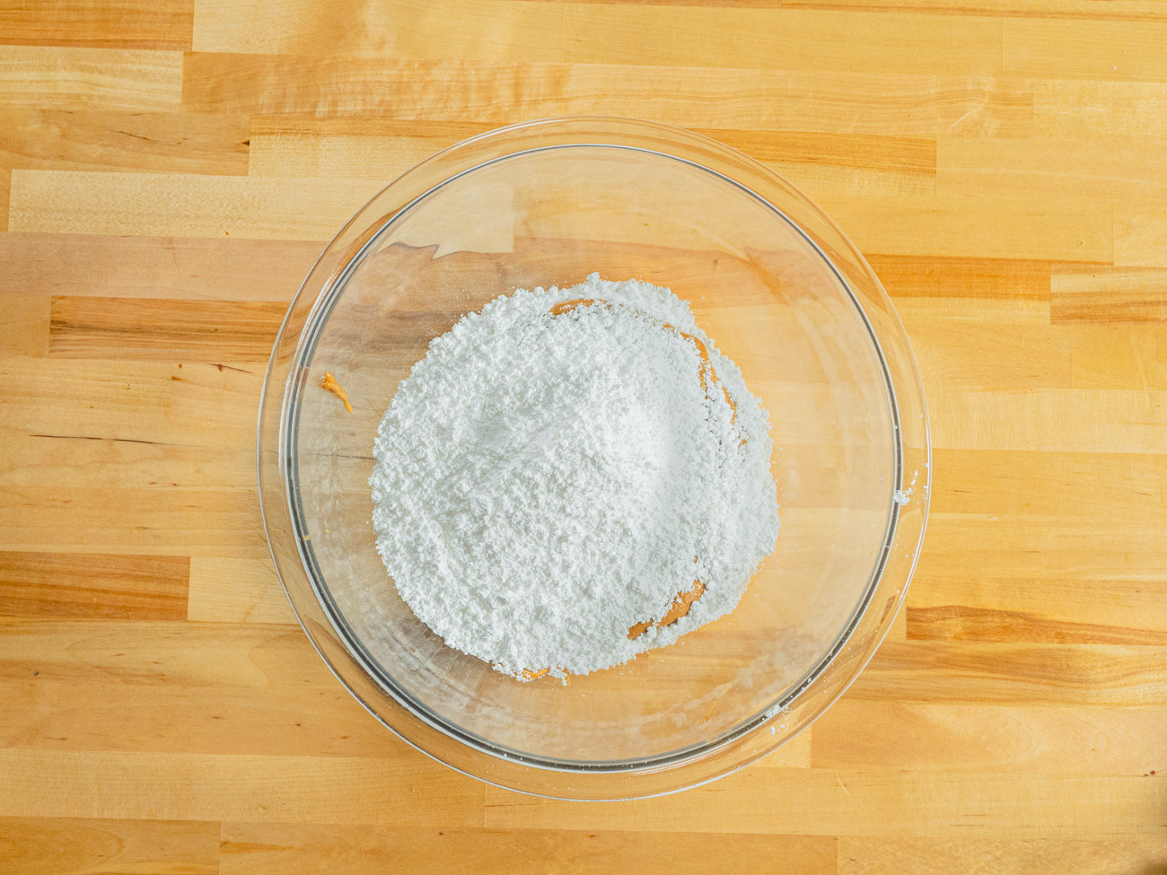 Meanwhile, mix powdered sugar and peanut butter in a medium-sized bowl. Form the mixture into about 1 inch balls (1 for each cookie). Set aside.