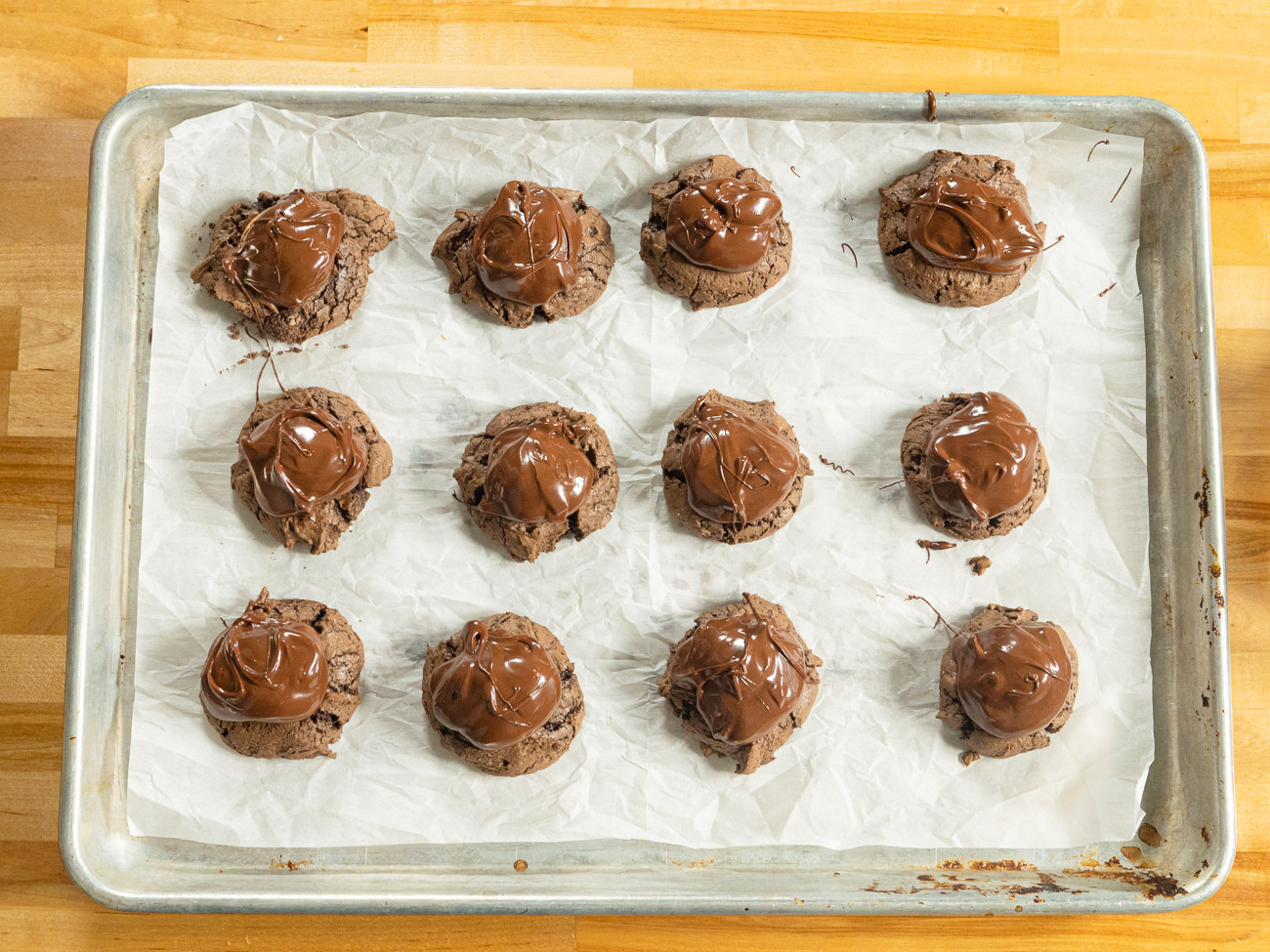 Melt chocolate in a microwavable bowl in 30-second increments. Spoon about 1/2 a tablespoon of melted chocolate on top of each cookie so it covers the peanut butter ball. Let the chocolate set. Store in an airtight container.