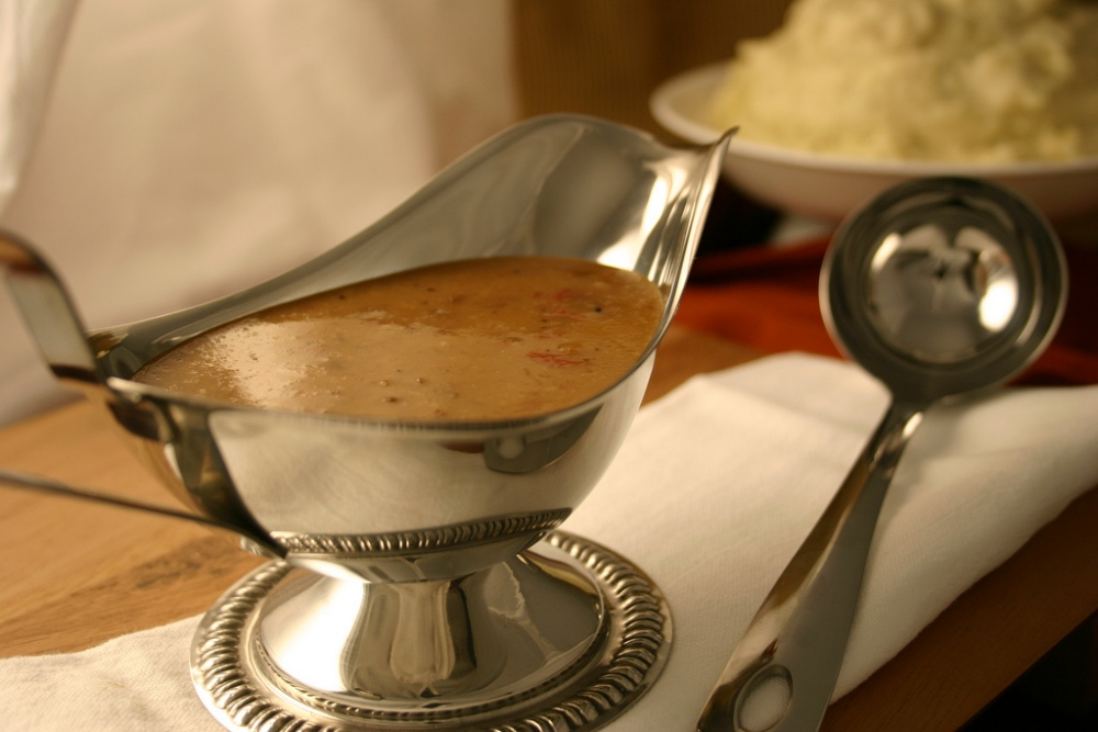 metal gravy boat filled with gravy