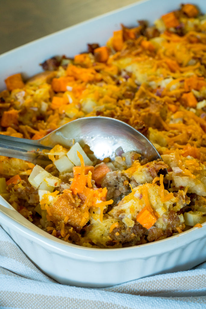 Close up of scooping out breakfast cowboy casserole