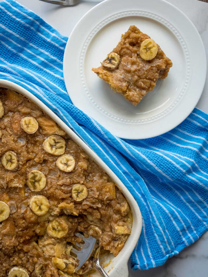 Top down photo of french toast casserole in a pan and on a plate with bananas on top