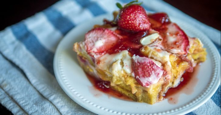 Close up of strawberry french toast casserole with icing on top