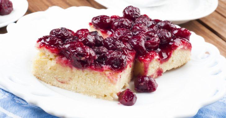 Dense white cake with dark red cherry topping
