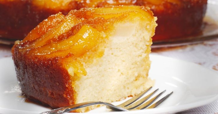 Side view of cake with caramelized peach slices on top