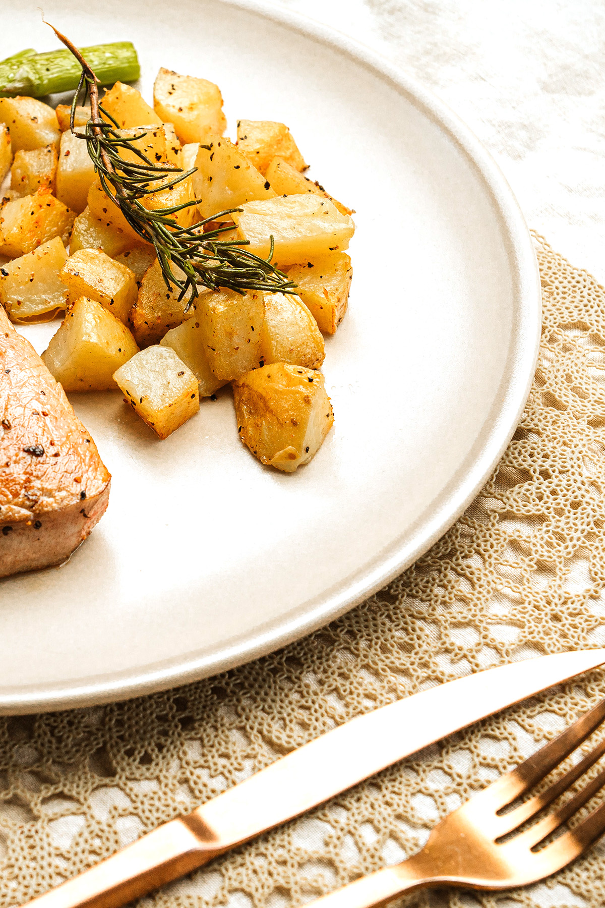 pork chop and potatoes on a plate