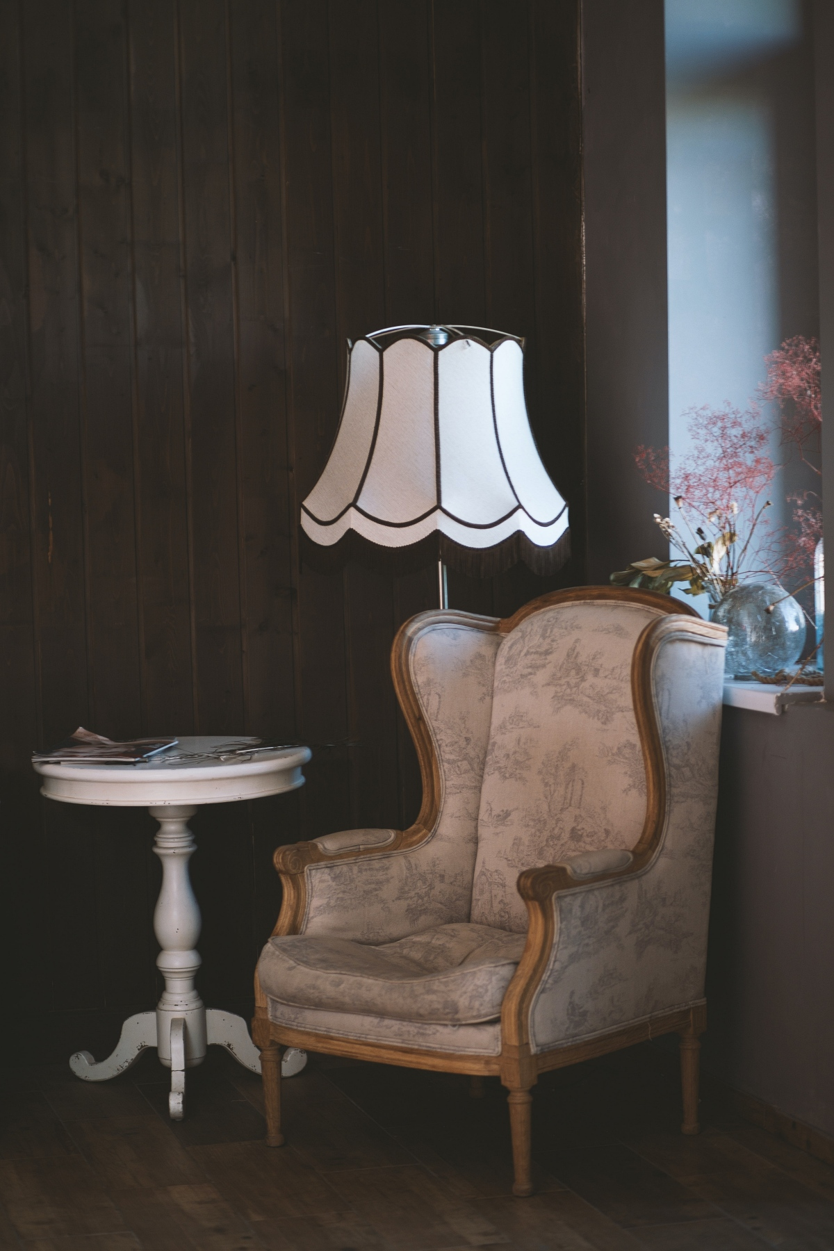 toile wing chair and side table