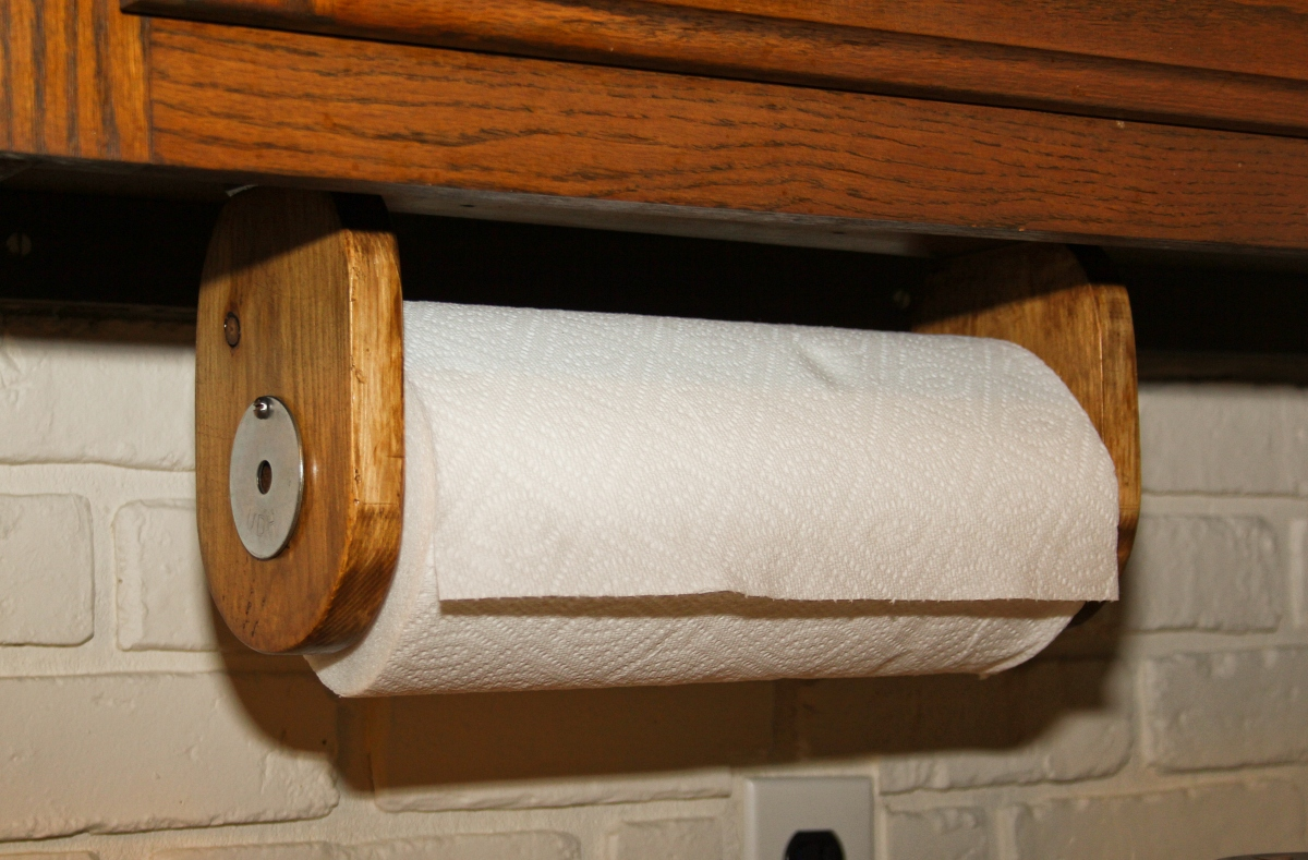 paper towel roll on wooden holder